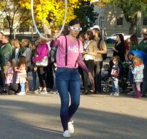 Women in Physics president Aurora Popescu, an accomplished hula-hooper, handed out rainbow diffraction glasses during CSU's 2017 homecoming parade.