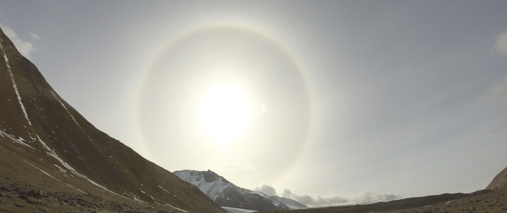 color photo of the sun looming large in Garwood Valley, Antarctica