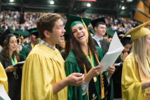 students singing at commencement