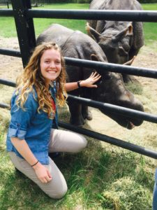 molly corder with rhinos