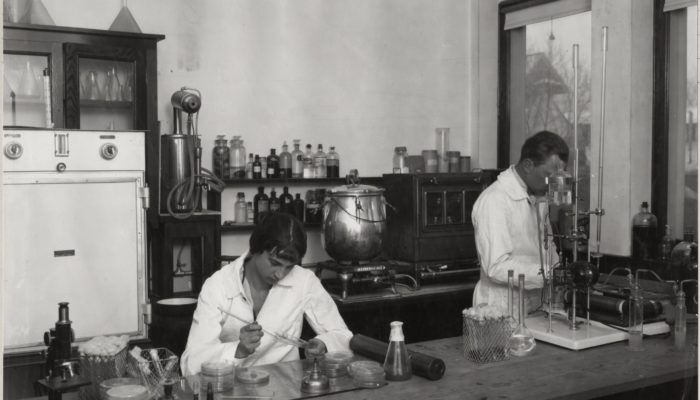 Historic photo of researchers in a laboratory
