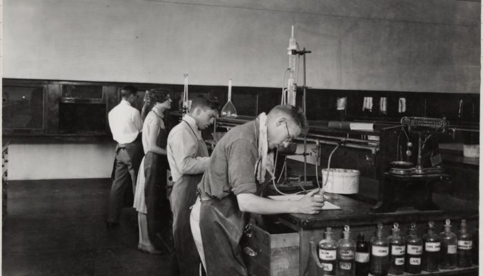 historic photo of students in a lab