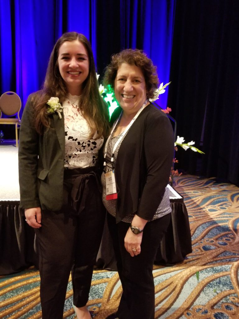 Image of Angela Hanna, chemistry grad student and Professor Ellen Fisher at AVS National Award Ceremony