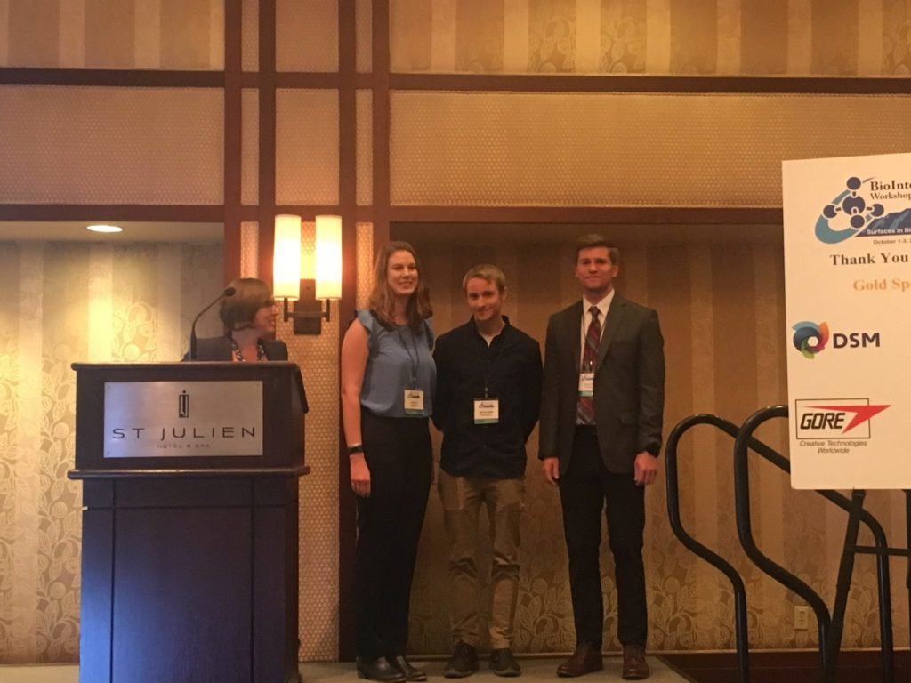 Image of Hailey Hibbard and two other students at the BioInterface Award show in Boulder, CO