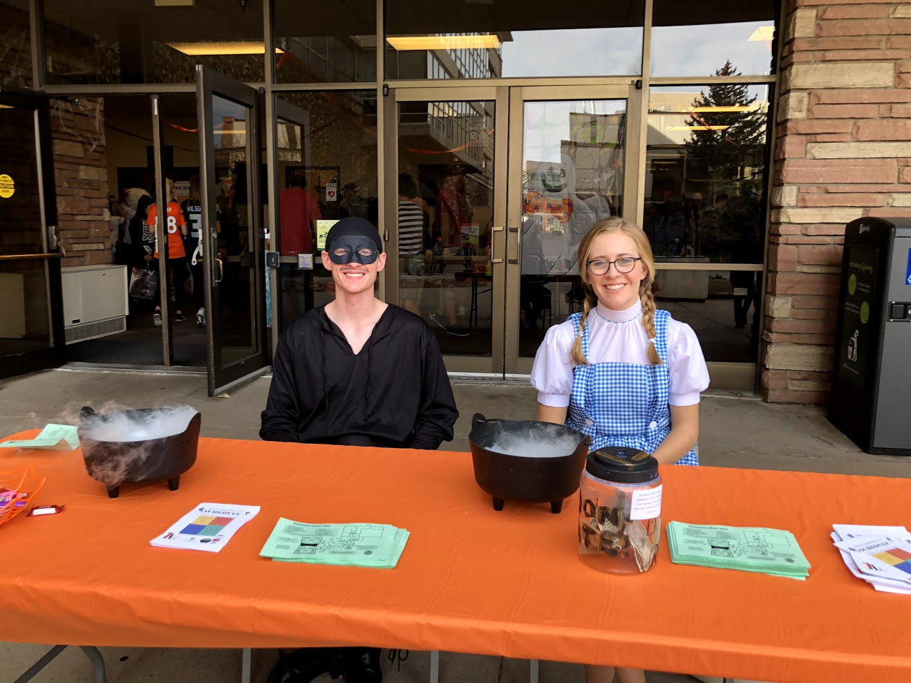 Image of chem club members greeting visitors at Halloween show