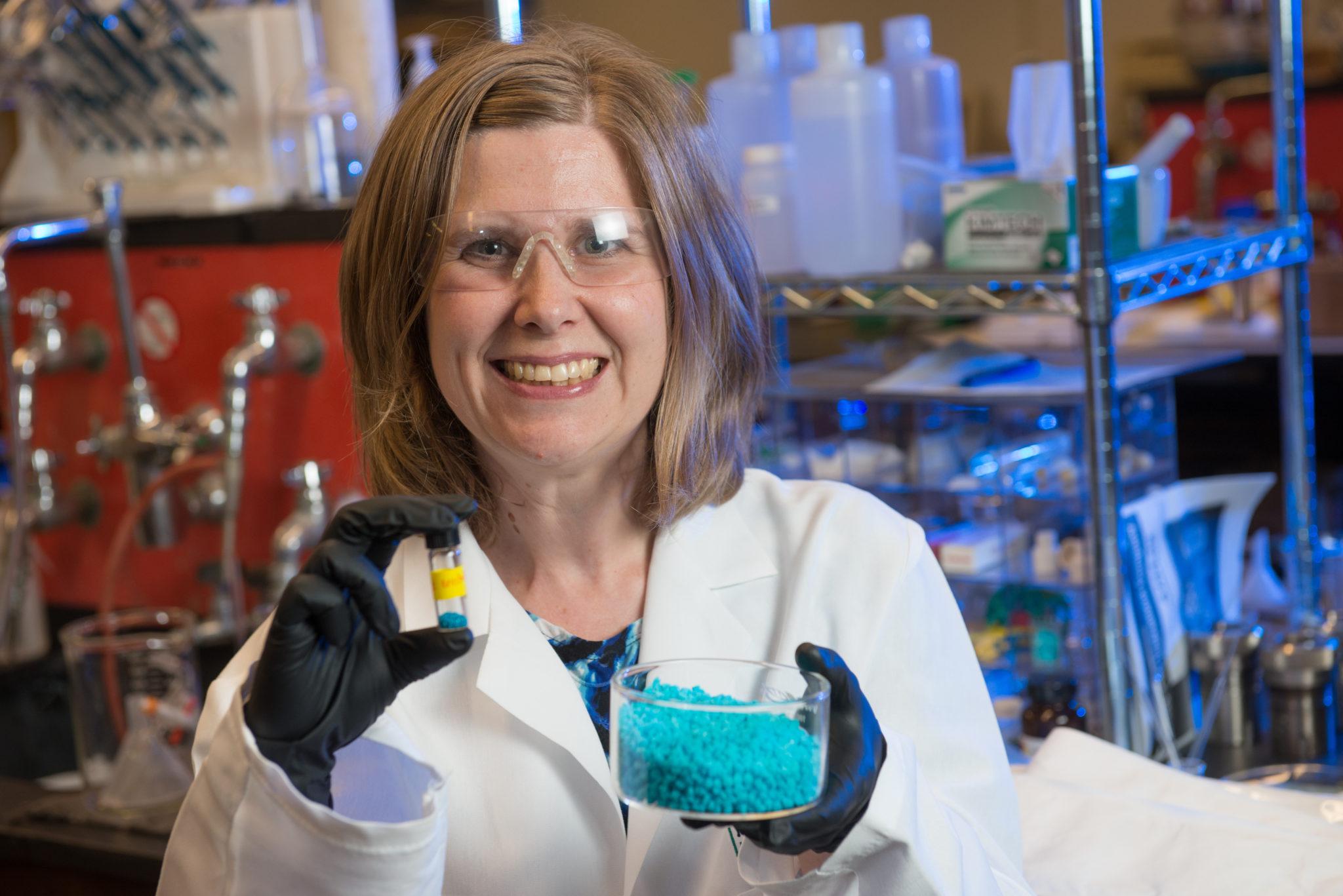 Melissa Reynolds holding metal organic framework crystals