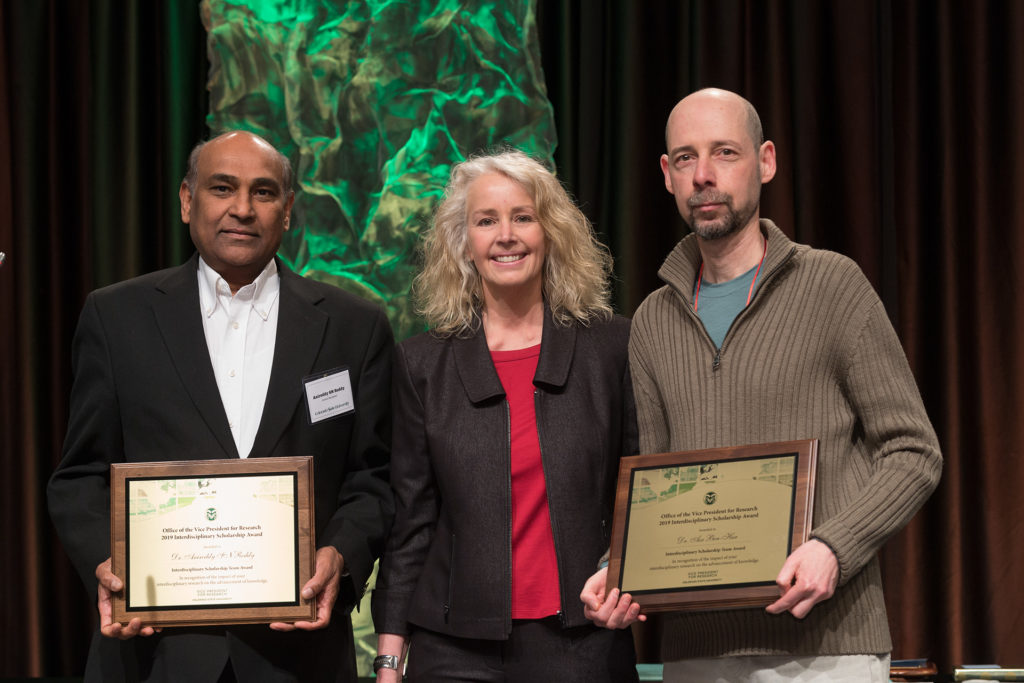 photo of Asa Ben-Hur and Anireddy SN Reddy with IDSA plaques at award ceremony