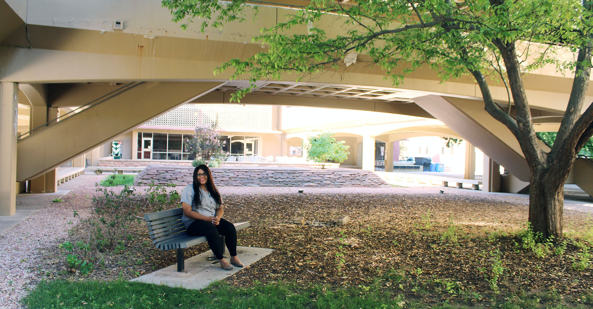 Sarah Hervey sits outside Clark building at Colorado State University.