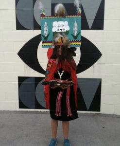 Rasa Humeyumptewa is dressed in traditional Hopi Tribe regalia.